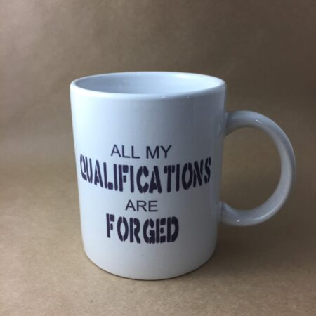 "Gameco Lad Coffee Mug ""ALL MY QUALIFICATIONS ARE FORGED"""